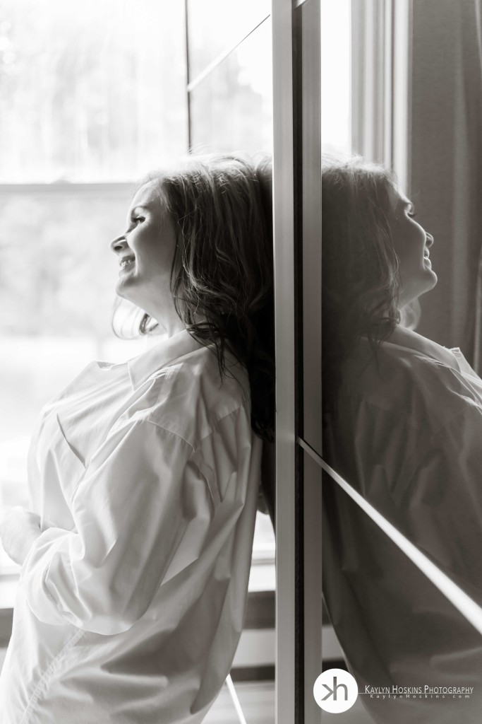 Boudoir client laughing while reflected in ikea closet