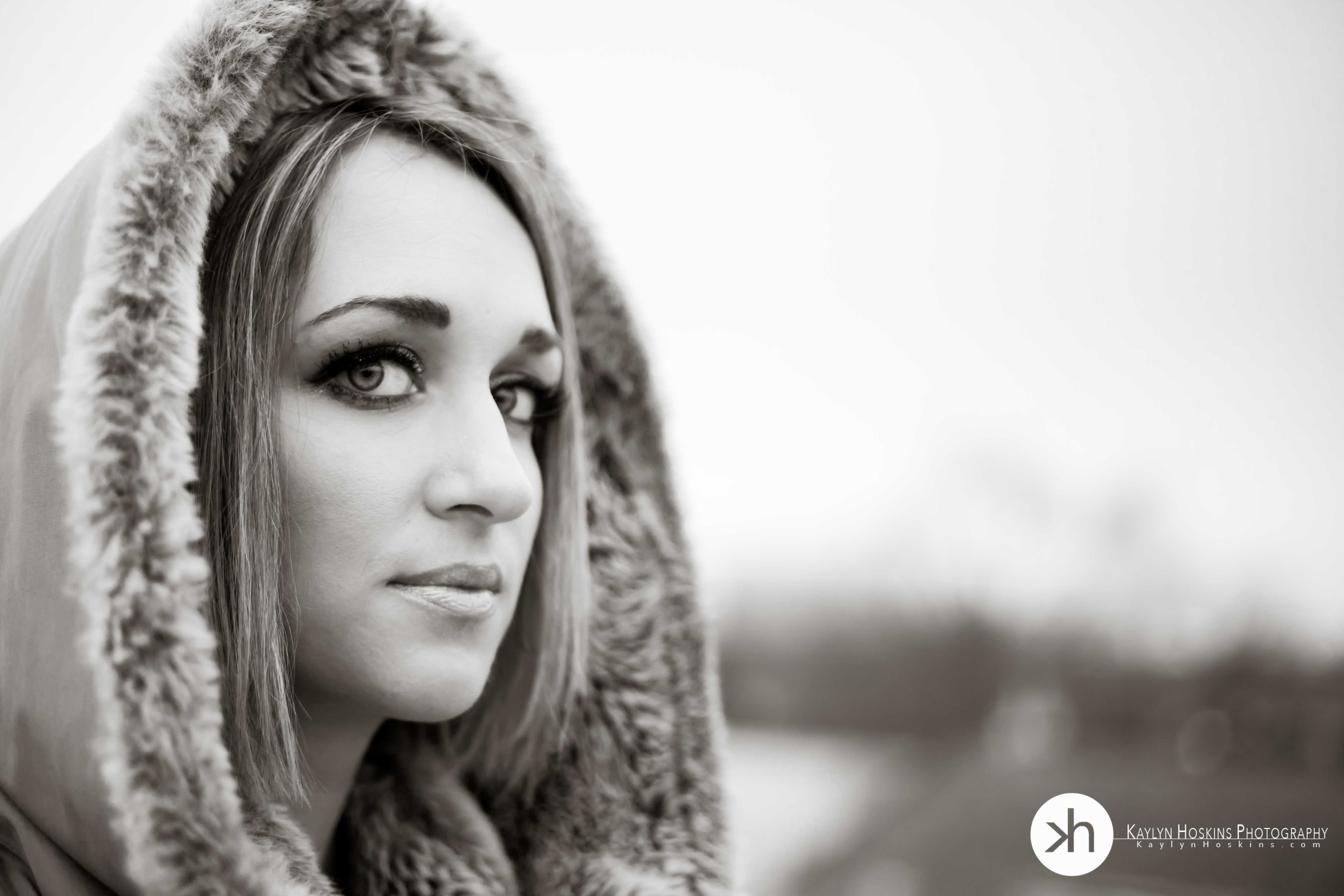 beautiful woman wearing winter hood during outdoor boudoir session