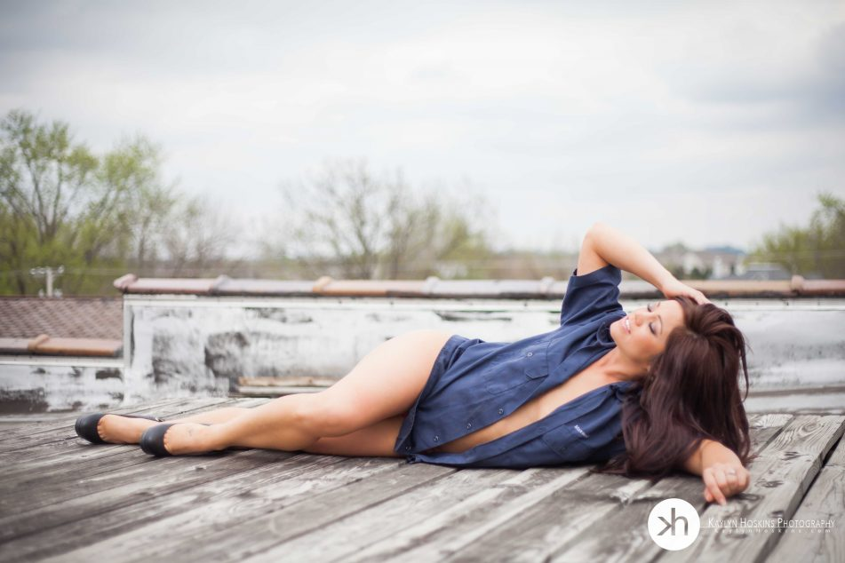 Boudoir client lays on rooftop during boudoir experience in solon, iowa