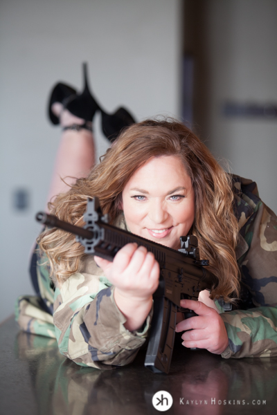 Sexy Veteran laying on bar with gun in army fatigues during boudoir session