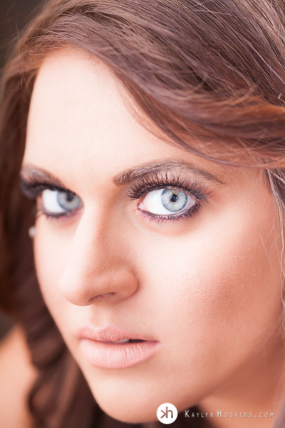Magical Blue Eyed Goddess close up during boudoir experience at Kaylyn Hoskins Photography