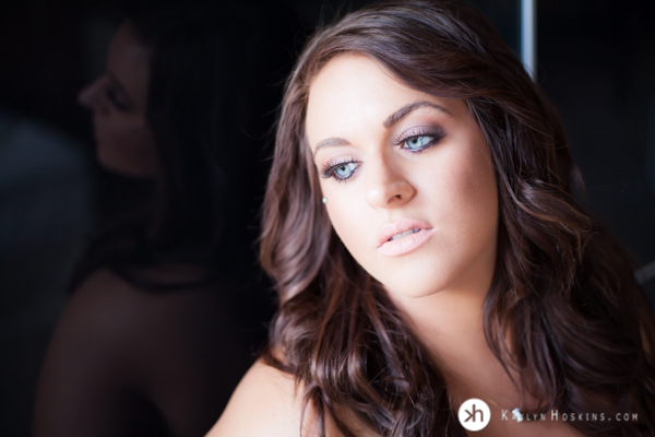 Boudoir Goddess looks away from camera in lingerie during her boudoir experience with Kaylyn Hoskins Photography in Solon, Iowa