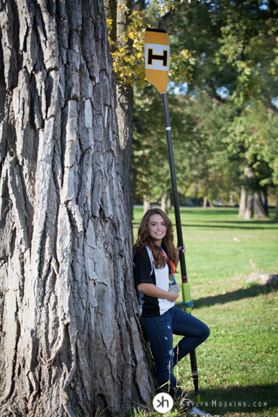 Solon Senior & Junior Rower Aurora leaning on tree at the P. Sue Beckwith, M.D. Boathouse in Iowa City