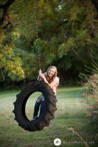 Gorgeous Senior Gracen playing on tire swing during senior photos
