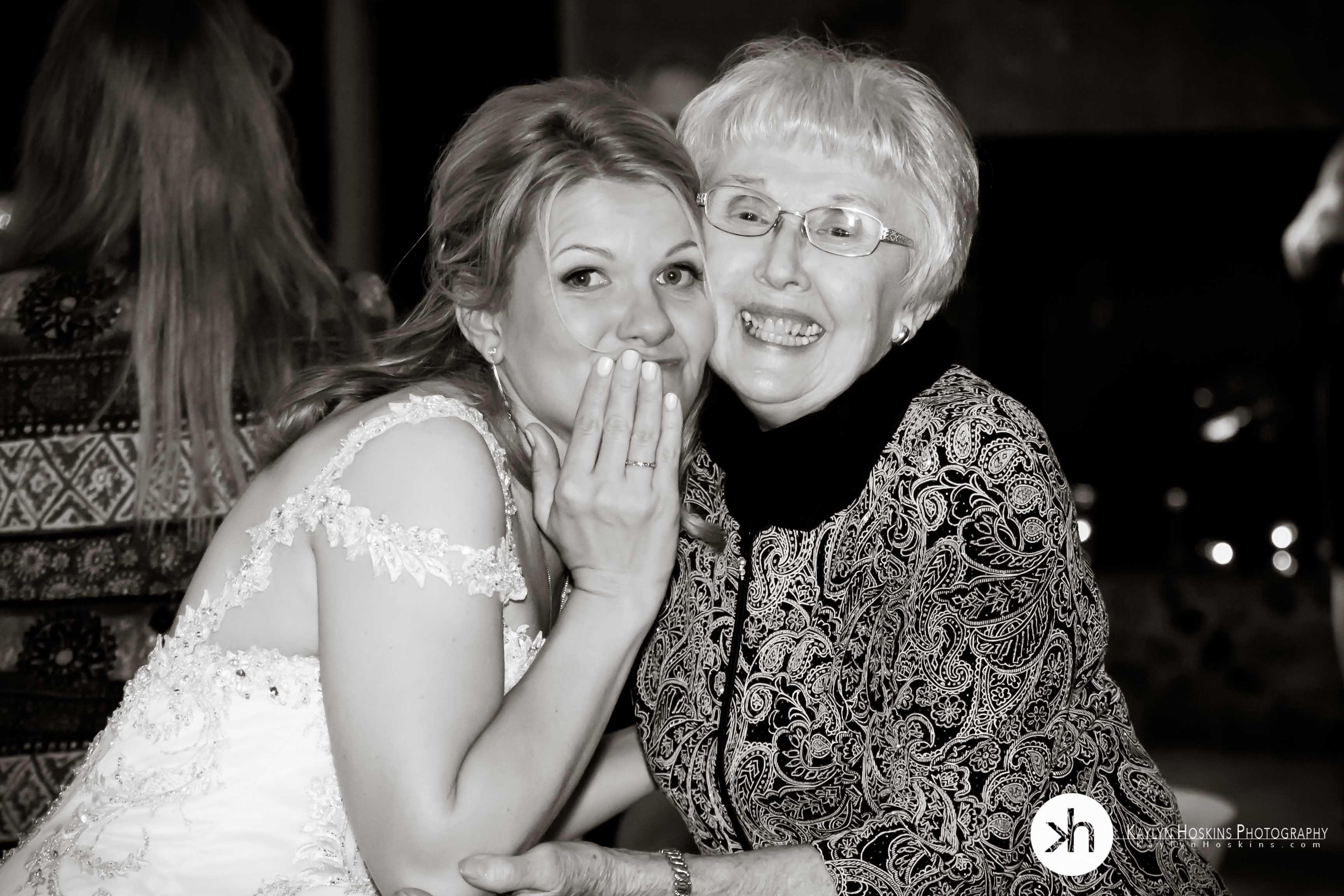 Grandma smile big with the bride during wedding reception in Des Moines Iowa