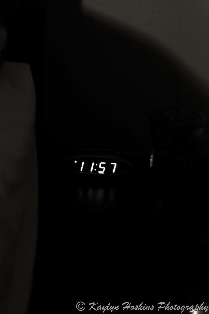 Digital clock reading 11:57 PM