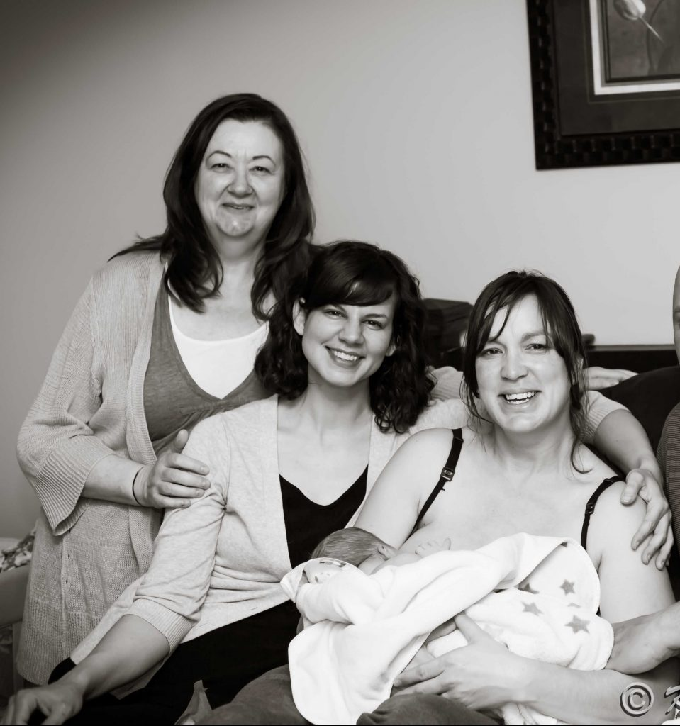 Midwives with Mother and newborn water birthed boy