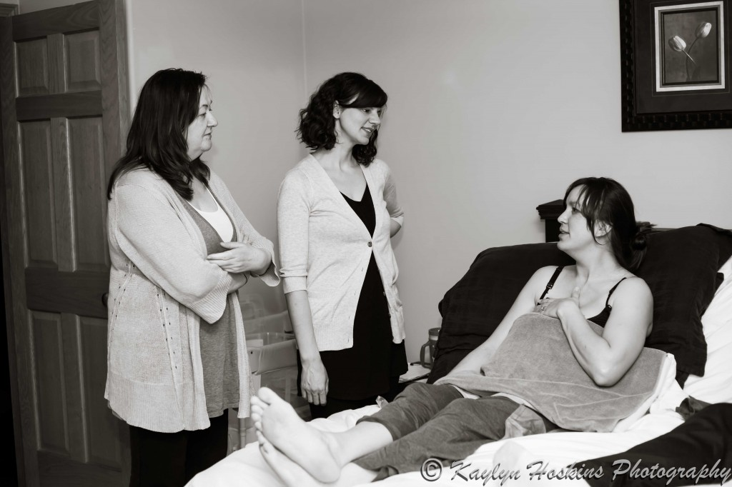 midwives talk to new home birth Mother before they leave for the night