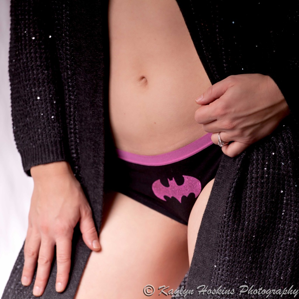 Boudoir babe shows her sexy super hero panties
