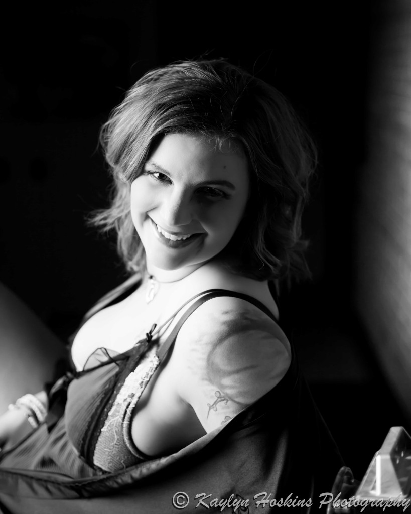 Boudoir Client smiles beautifully during boudoir experience in Solon, IA