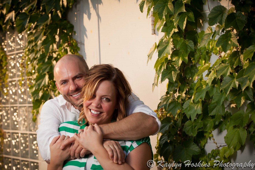 engagement couple smile at camera during photo shoot in New Bo area Cedar Rapids, Iowa