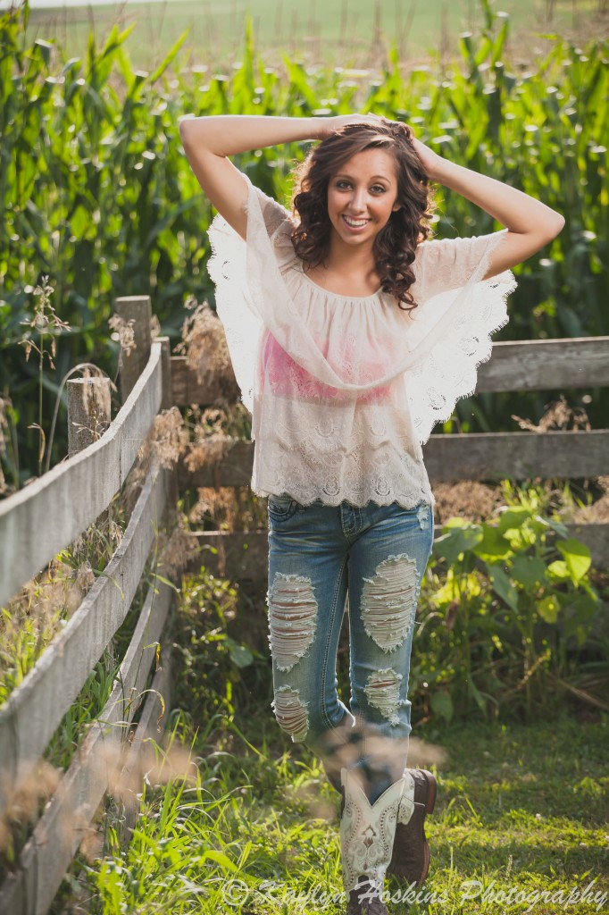 Solon senior poses by corn field in West Liberty during her shoot with Kaylyn Hoskins Photography