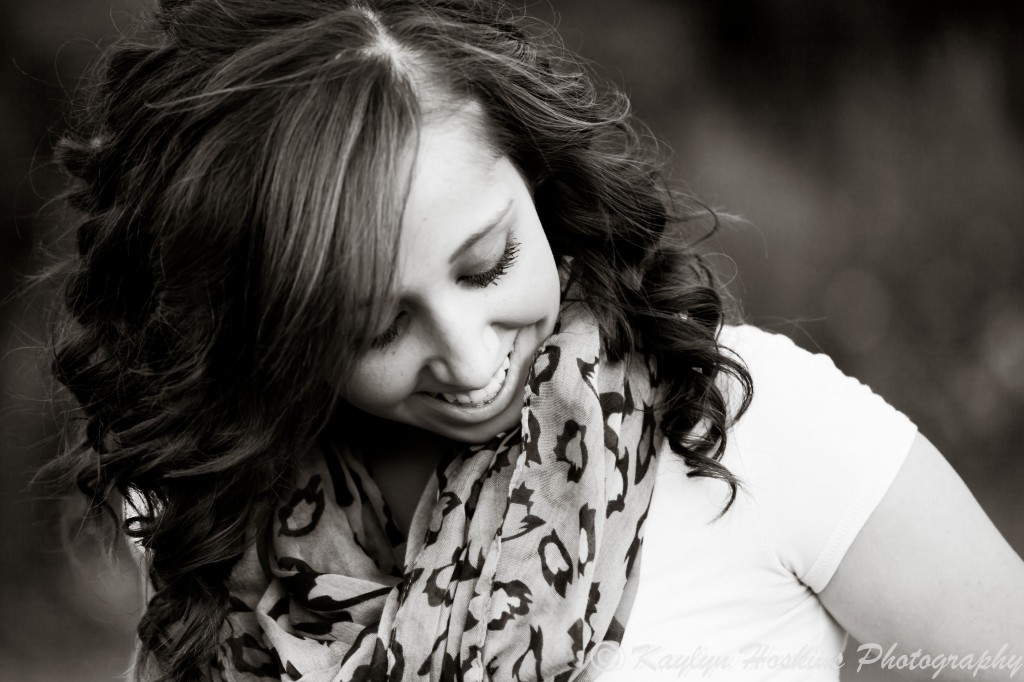 Beautiful Senior laughs during senior pics session with kaylyn hoskins photography