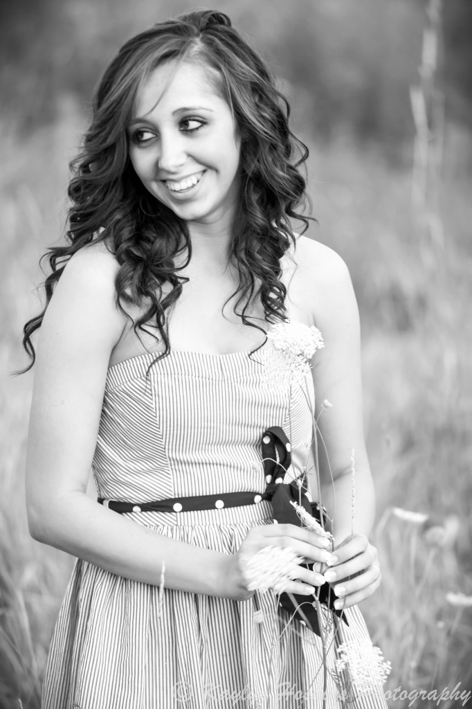 The Gorgeous Addie plays with queen anne's lace during her senior pics with Kaylyn Hoskins Photography