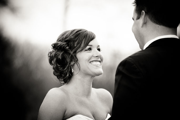 bride grins big as her groom sees her for the first time at Bella Sala in Tiffin, Iowa