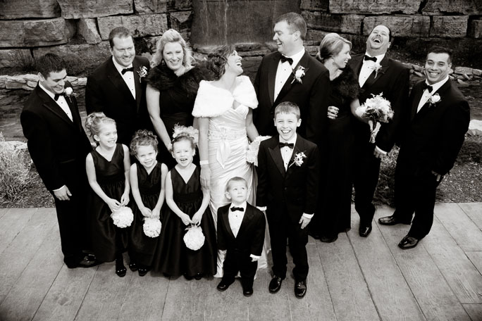 Wedding Party laughing during photos at Bella Sala in Tiffin, Iowa