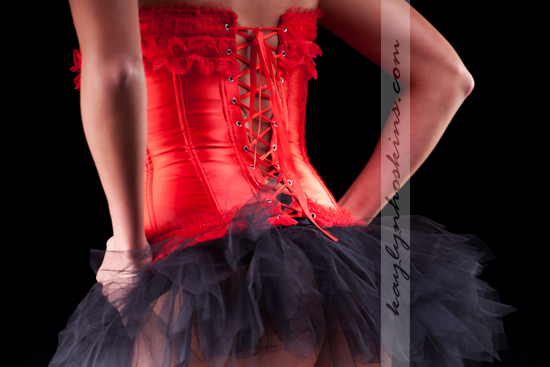Lacie Joy rocking her tu-tu and red corset during her boudoir session with Kaylyn Hoskins Photography