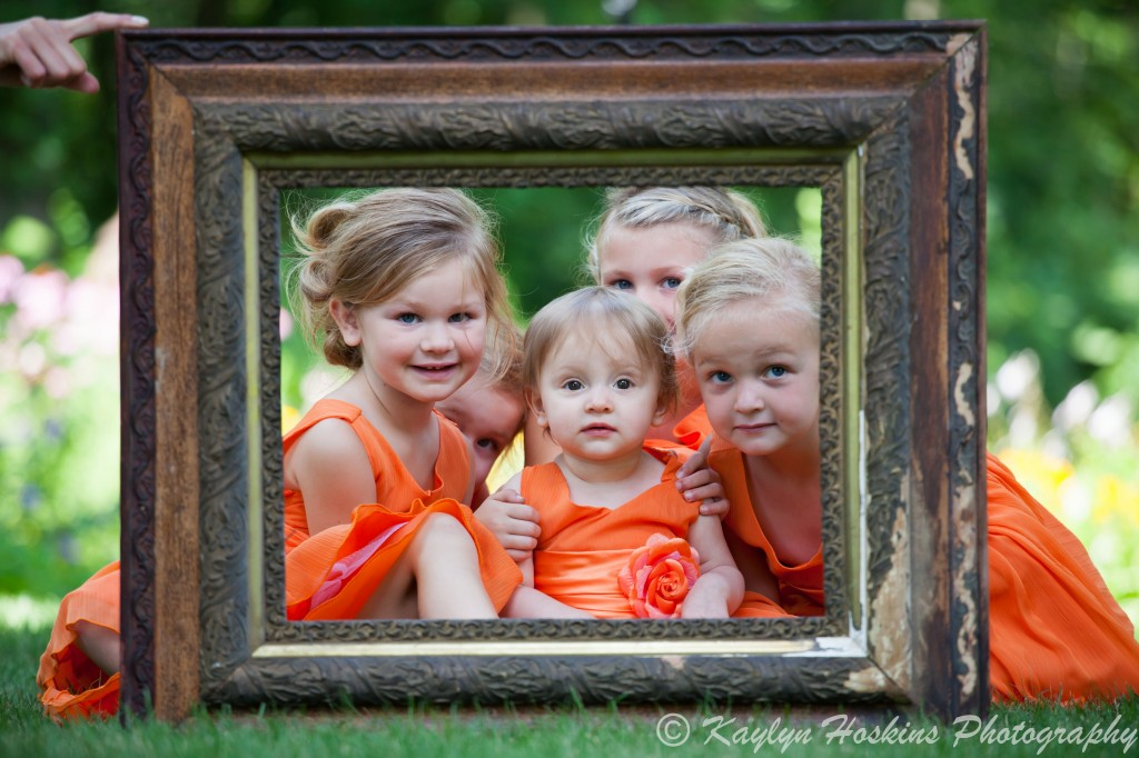 The adorable little ladies in a frame before the wedding at Little Brown Church in Nashua, IA