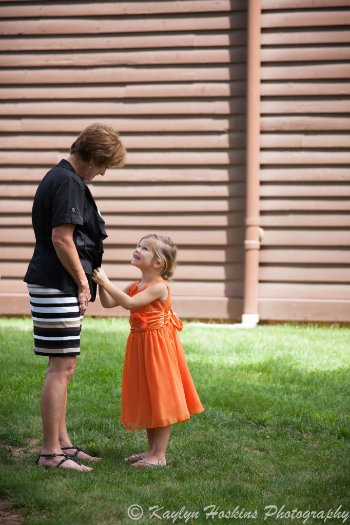 Grandmother and granddaughter share a sweet moment before the ceremony at the Little Brown Church in Nashua, IA