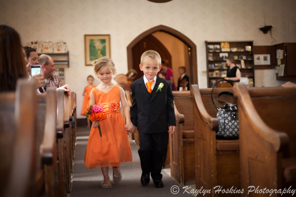 Sweet little kids walking up the isle for wedding at the Little Brown Church in Nashua, IA