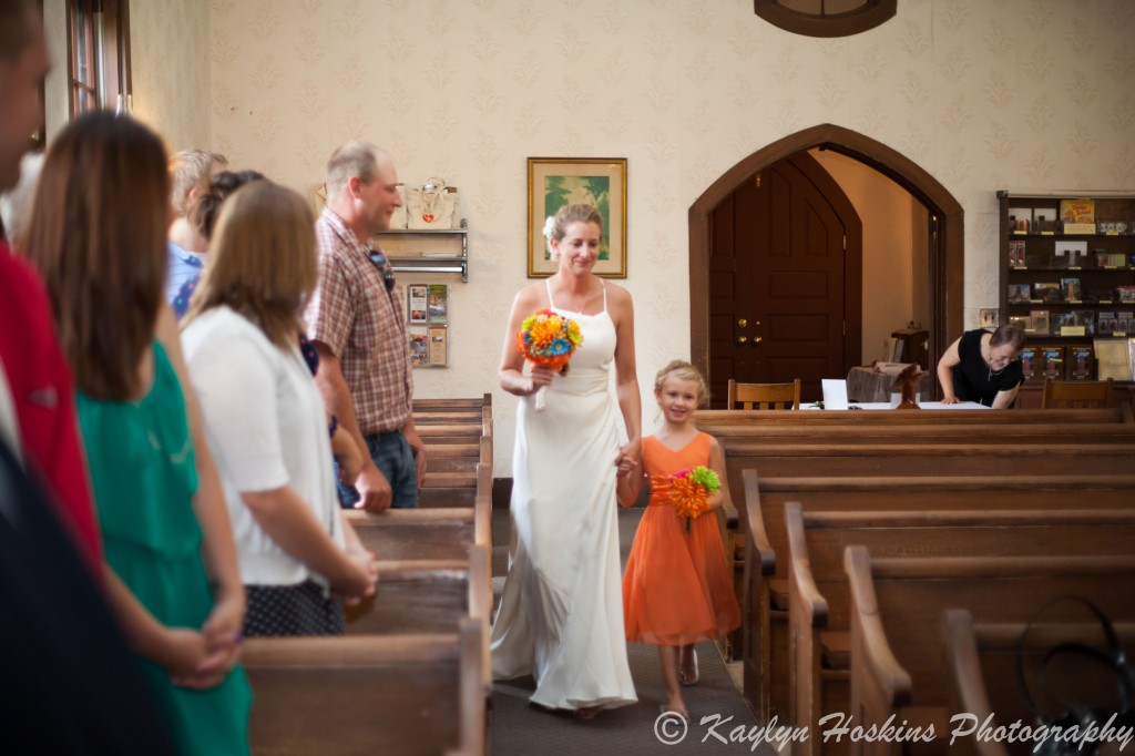 Bride's oldest daughter walks her down the isle to get married at the Little Brown Church in Nashua