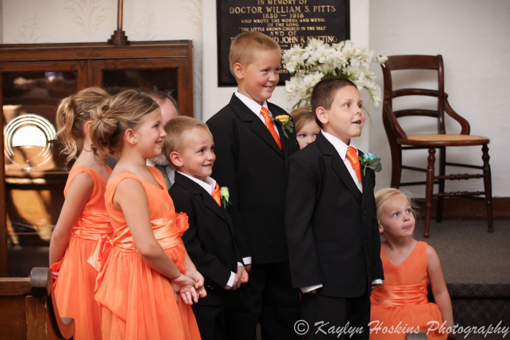 The kids tell the groom he can kiss his bride at Little Brown Church in Nashua