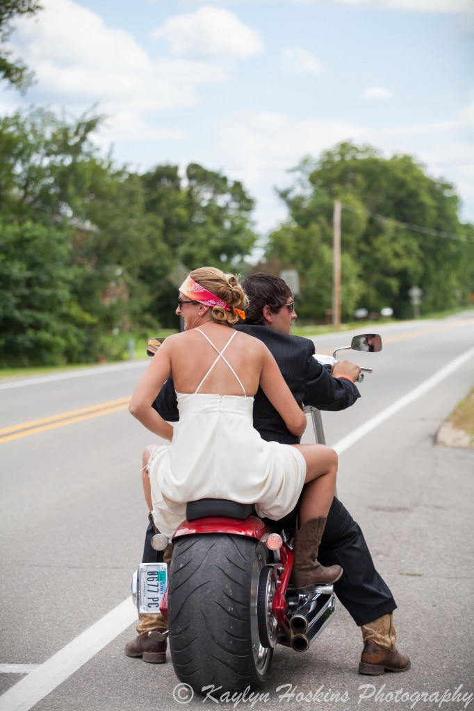 Bride and groom ready to ride off on harley to reception at the Little Brown Church in Nashua